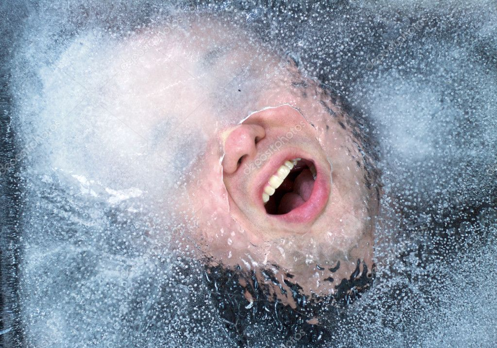Person trapped under the ice gasping for air.  Stock Photo #5392211