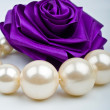 Pearls and artificial roses - Stock Photo