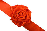 Red rose flower of satin ribbon — Stock Photo