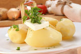 Parsley and butter on boiled potatoes — Stock Photo