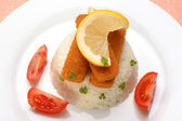 Fish fingers with rice on a plate — Stock Photo