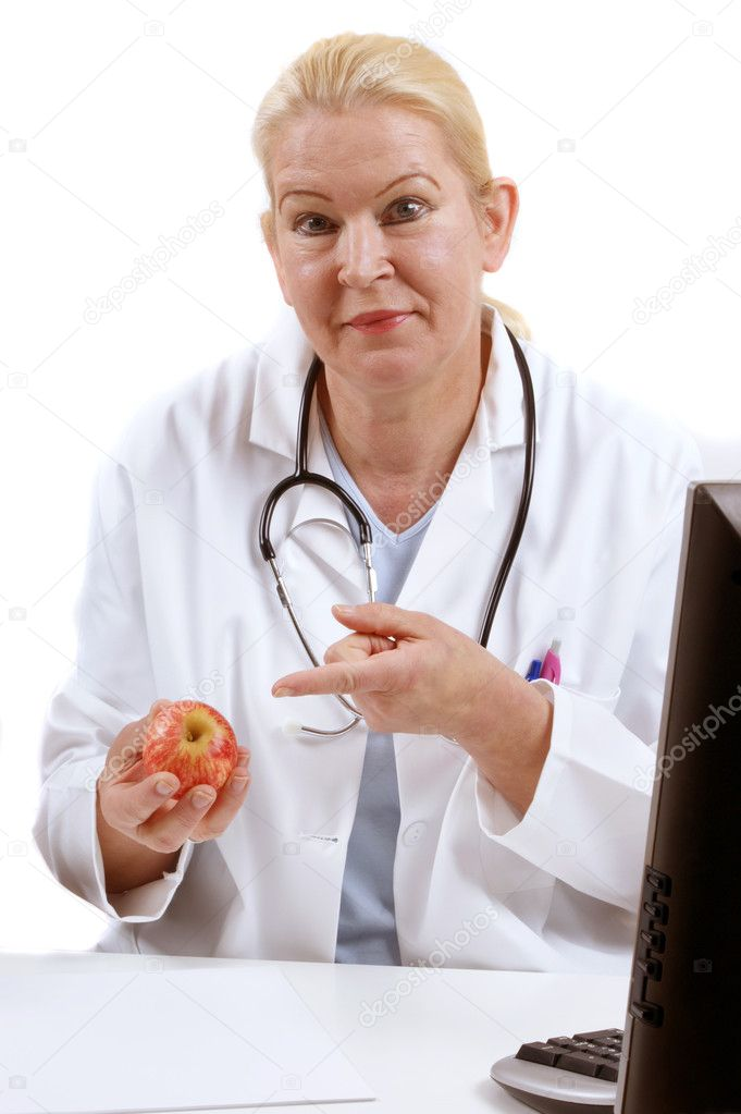 Medical staff with a healthy organic apple — Stock Photo #5631172