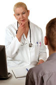 Medical staff in conversation with a patient — Stock Photo