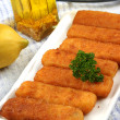 Fried fish sticks on a white plate — Stock Photo