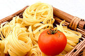Some home made tagliatelle in a wicker basket — Stock Photo