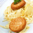 Fish cakes with homemade noodles on a plate — Stock Photo