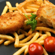 Stock Photo: Fish Burger with fried chips on pan