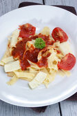 Pasta with tomato sauce and baked goat cheese — Stock Photo