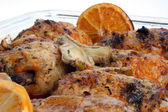 Grilled chicken thighs with orange and lemon — Stock Photo