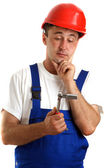 Craftsmen with safety helmet holding a wrench — Stock Photo