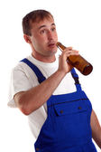 Craftsmen drinking a bottle of beer during work hours — Stock Photo