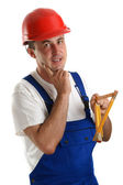 Craftsmen with safety helmet holding a ruler — Stock Photo
