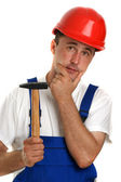 Craftsman with a white T-shirt holding a hammer — Stock Photo