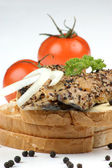 Smoked mackerel fillet on toast with pepper and tomato — Stock Photo