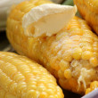 Boiled corn on the cob with butter and salt — Stok fotoğraf