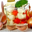 Mozzarella with cherry tomatoes in a jar with oil - Stock Photo