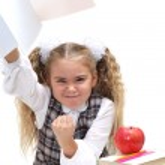Schoolgirl shake her fist — Stock Photo
