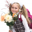 Schoolgirl with flowers — Stock Photo