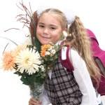 Schoolgirl with flowers — Stock Photo