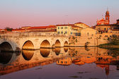 Tiberius' Bridge at sunset. Rimini, Italy — Stock Photo