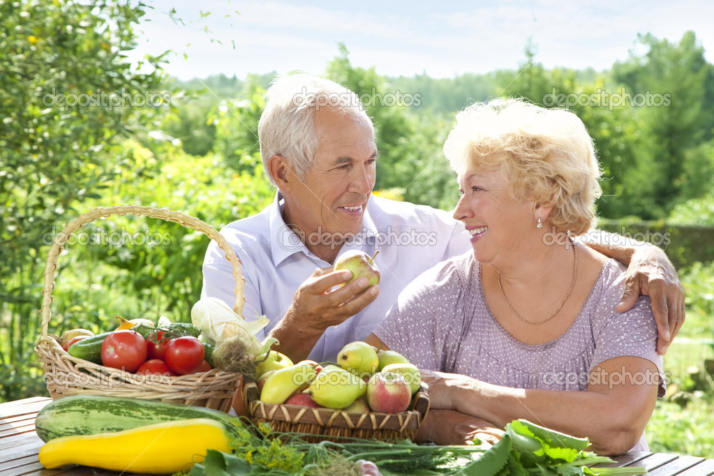 Happy elderly couple with this year's rich harvest  Stock Photo #6642050