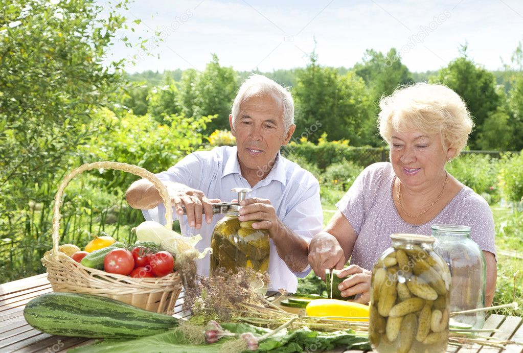 Mature couple making home made pickles — Stock Photo #6642053