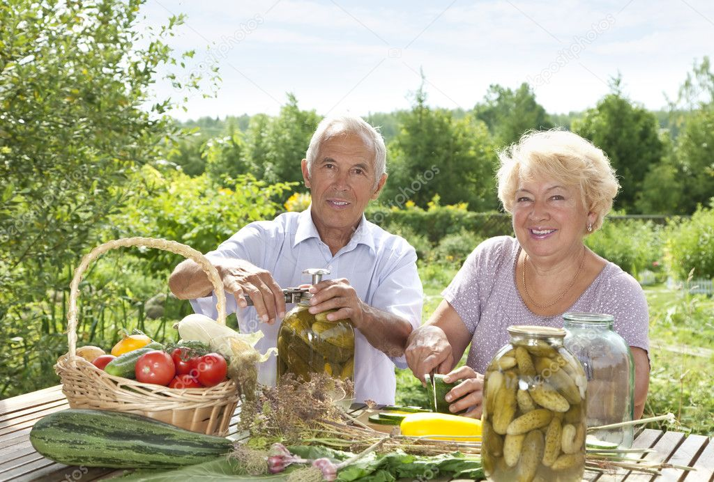 Mature couple making home made pickles — Photo #6642067