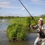 Elderly fisherman — Stock Photo