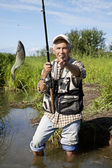 Fisherman fly fishing in a lake — Stock Photo