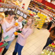 Mother and Friends in Grocery Store — Stock Photo