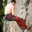 Male Climber Repelling - Stock Photo