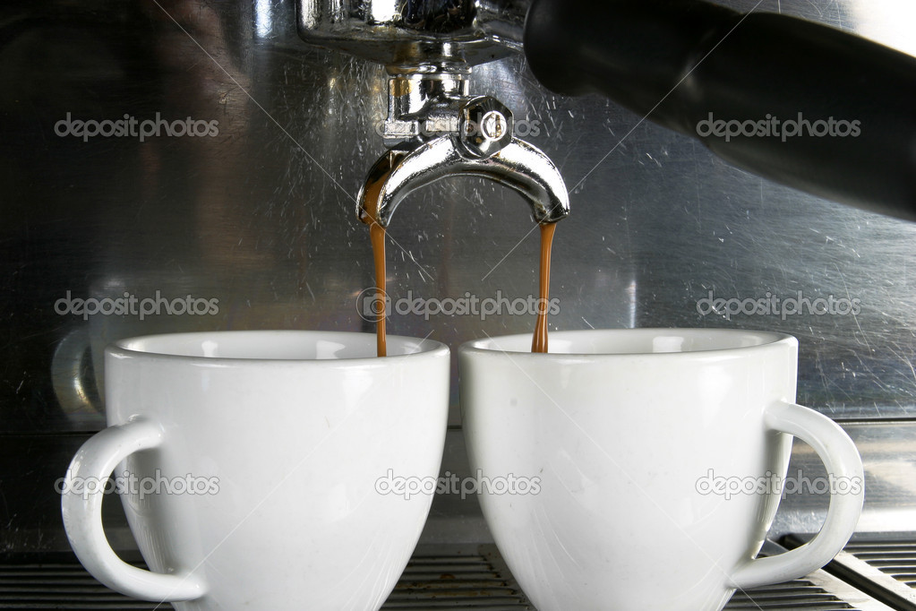 Detail image of two cups of espresso being made in an industrial profesional machine — Stock Photo #5678567