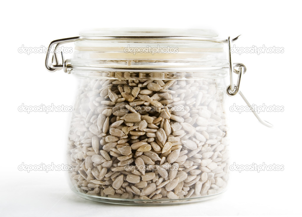 Bulk sunflower seeds on white. — Stock Photo #5679008