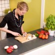 Woman Cutting Vegetables — Stock Photo #5680388