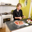 Young Female Making Pizza — Stock Photo #5680993