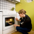 Watching Pizza Bake - Stock Photo