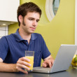 Using Computer with Juice — Stock Photo #5681809