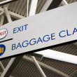 Baggage Claim & Exit Sign - Stock Photo