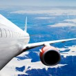 Airplane over Iceland - Stock Photo