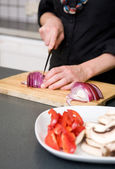Woman Slicing a Red Onion — Stock Photo