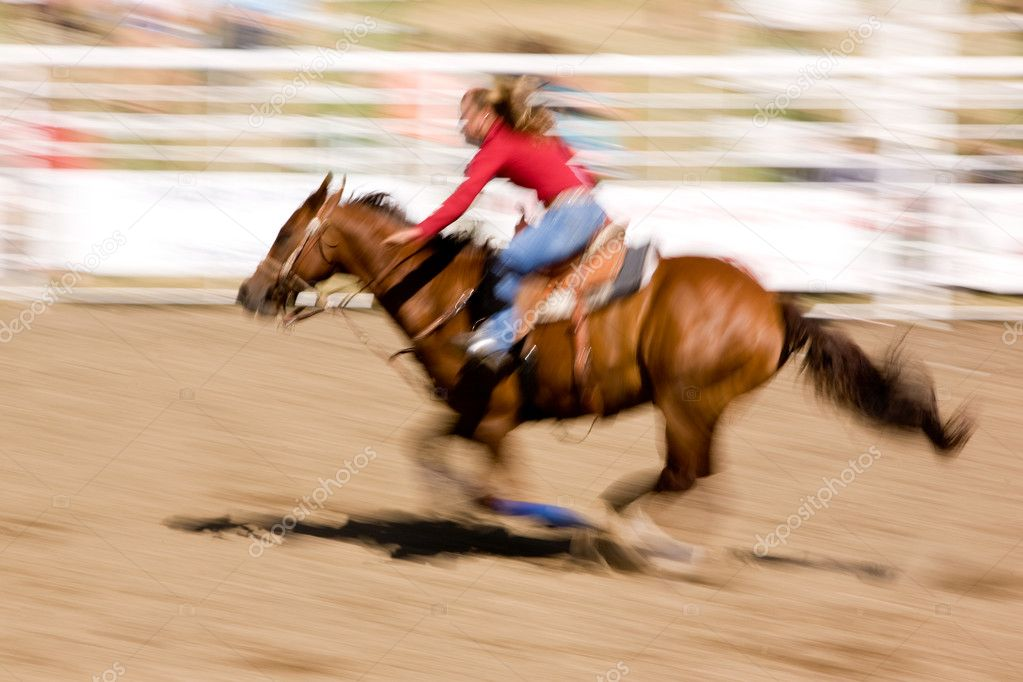 A horse running fast with a female rider - with motion blur. — Stock Photo #5682598