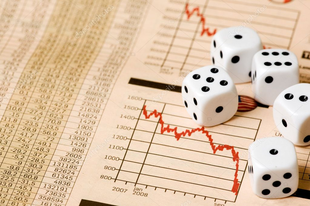 Dice and stock market charts in the newspaper  Stock Photo #5687858