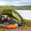 Camping with Laptop by Lake — Stock Photo
