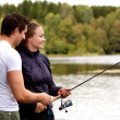 Man and Woman Fishing - Stock Photo