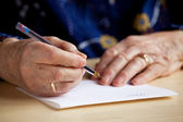 Writing a Letter — Stockfoto