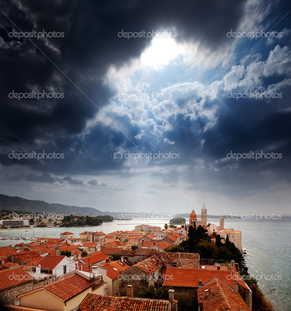 A medieval town with a dramatic storm filled sky  Stock Photo #5698840