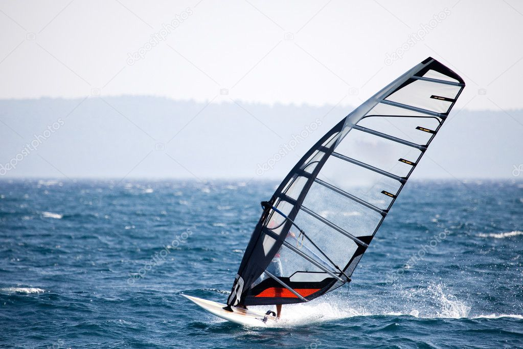 A wind surfer on the ocean  Stock Photo #5698850