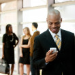 Business Man with Smart Phone — Stockfoto #5701906
