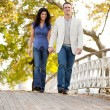 Royalty-Free Stock Photo: Couple Walk Bridge