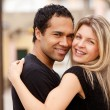 Hug Happy Couple - Stockfoto
